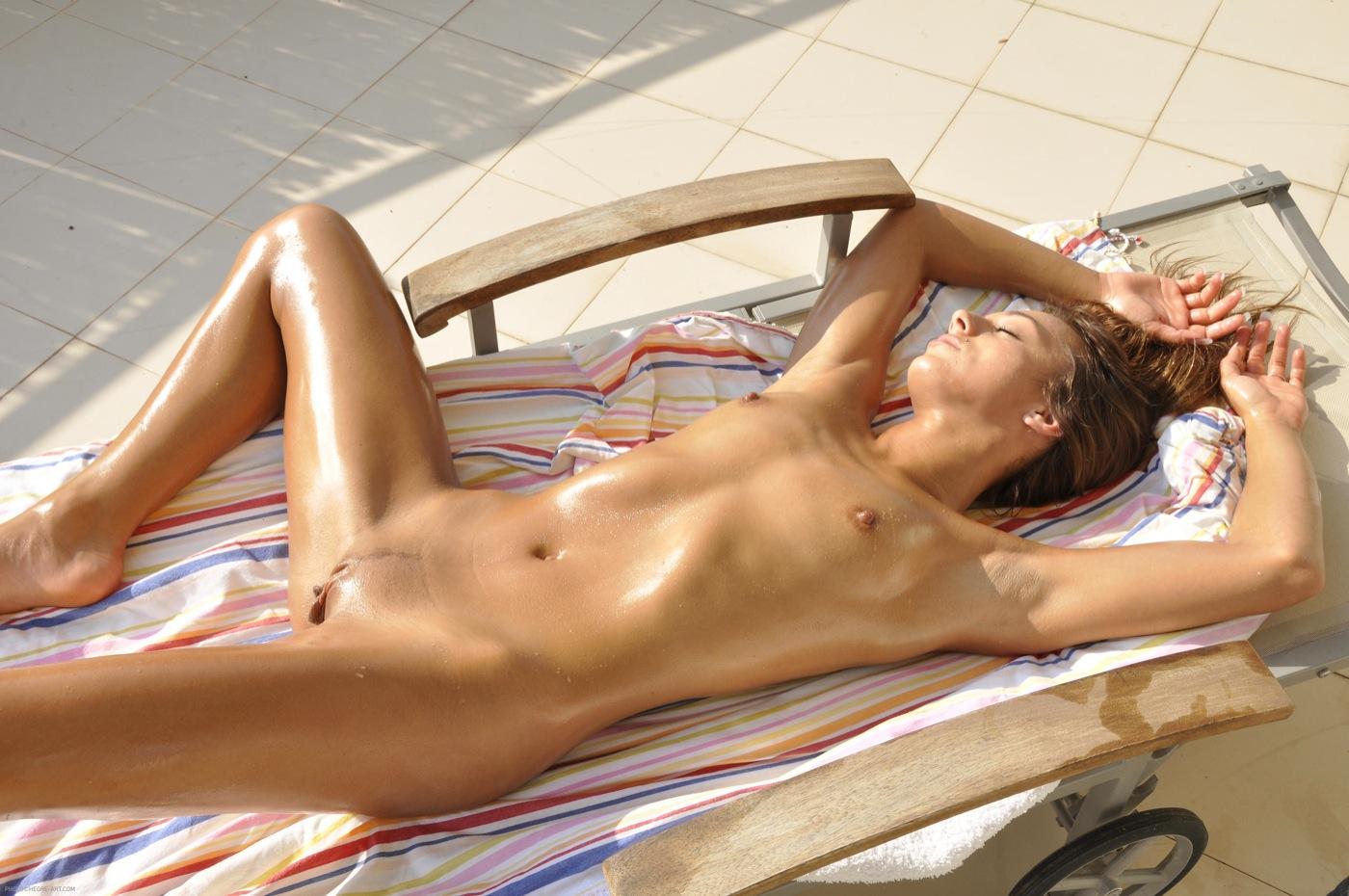 Sweet nude girls tanning on an empty beach